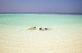Relax time at crystal clear lagoon of Banyan Tree Vabbinfaru