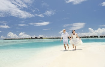 Couple on the beach of Paradise Island Resort & Spa