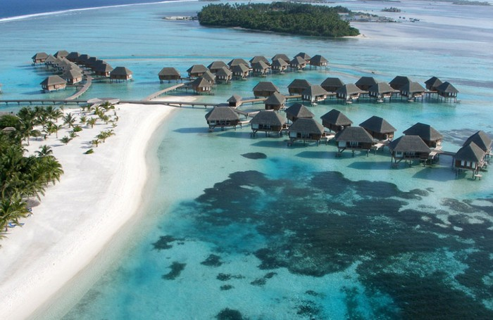 Aerial view of the beach, lagoon and water villas at Club Med Kani
